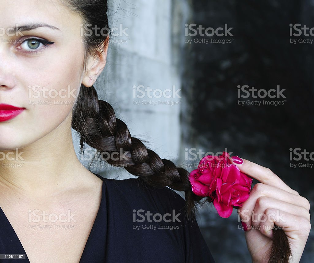 Plait with a red flower royalty-free stock photo