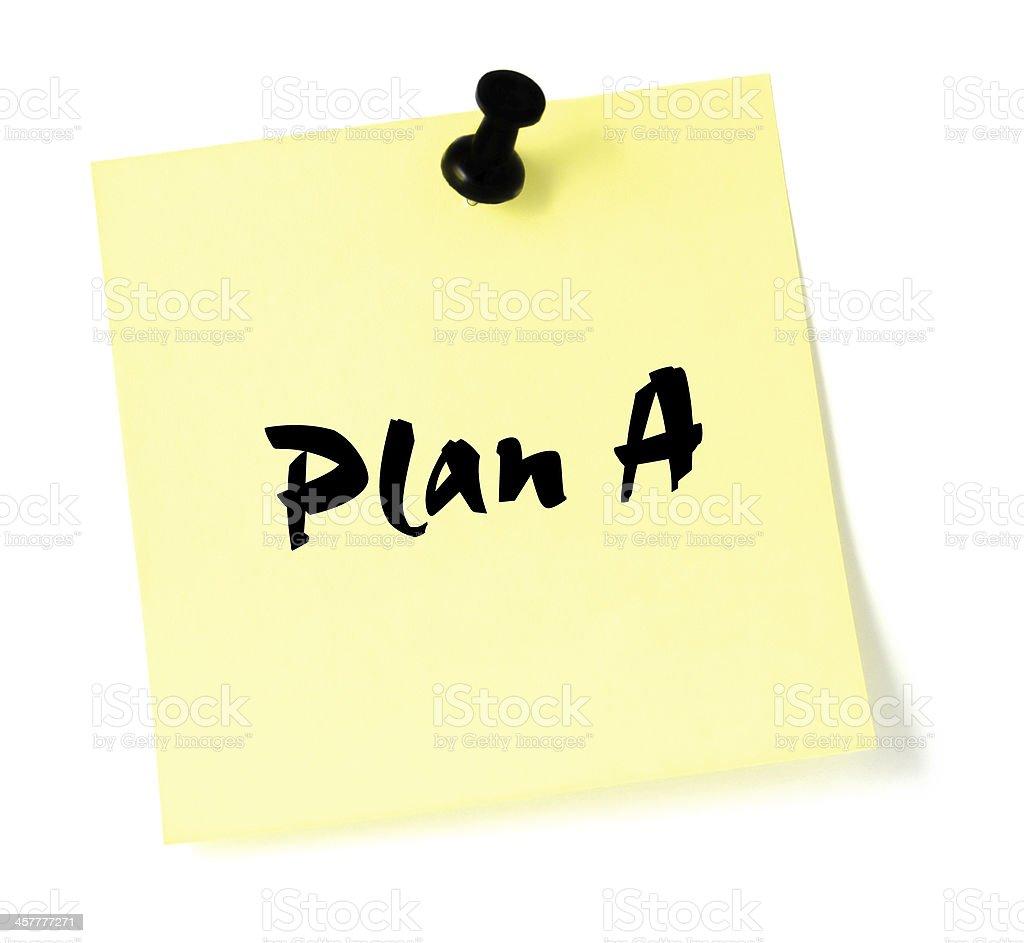 Plan A, written yellow sticky note sticker, black thumbtack pushpin stock photo