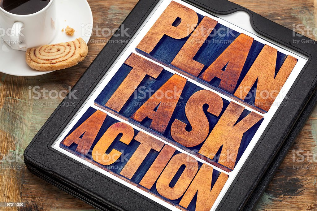 plan, task, action words on tablet stock photo