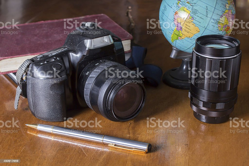 Plan to travel,camera with globe stock photo