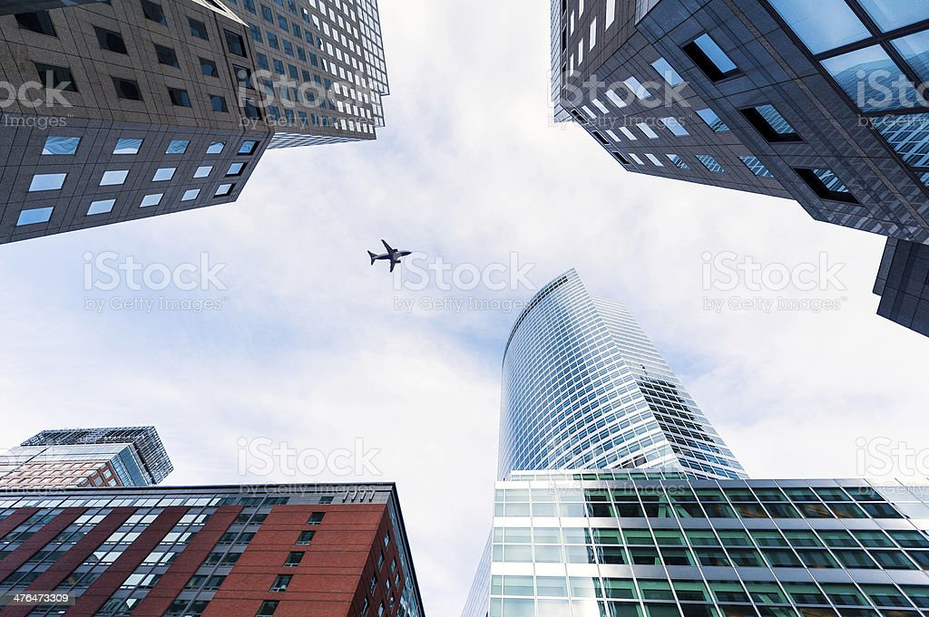 Plane above the city royalty-free stock photo