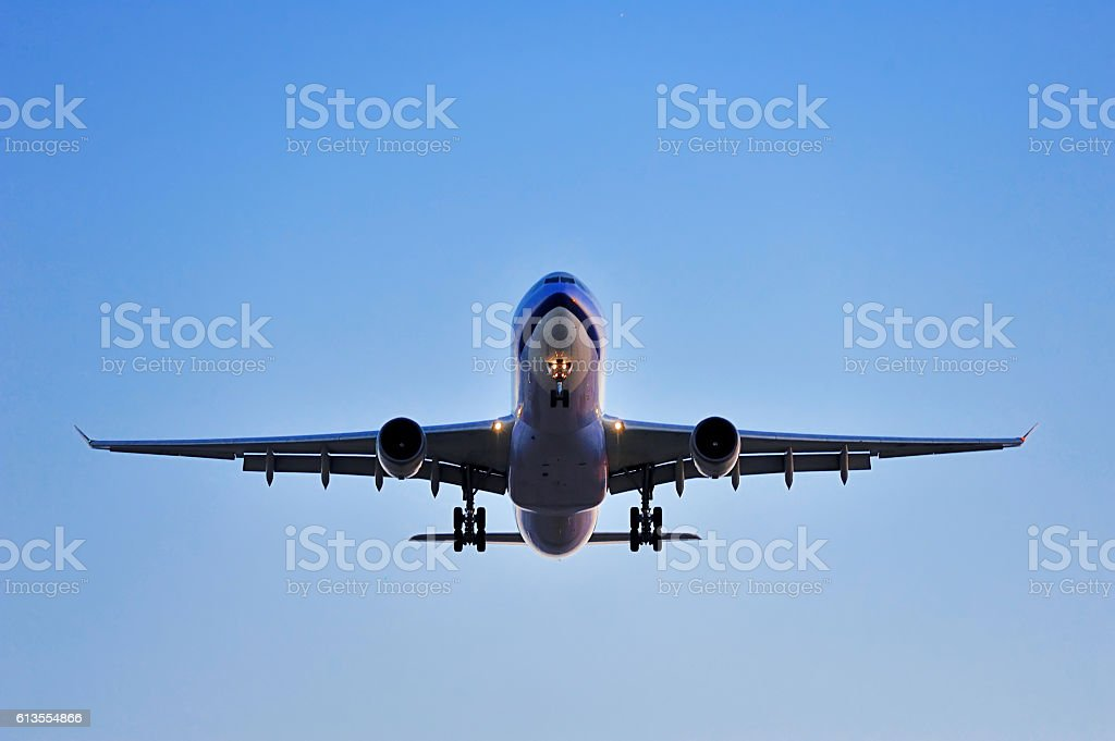 plane ahead in the air stock photo
