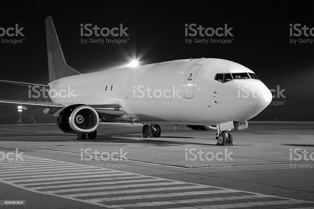 Plane at night stock photo