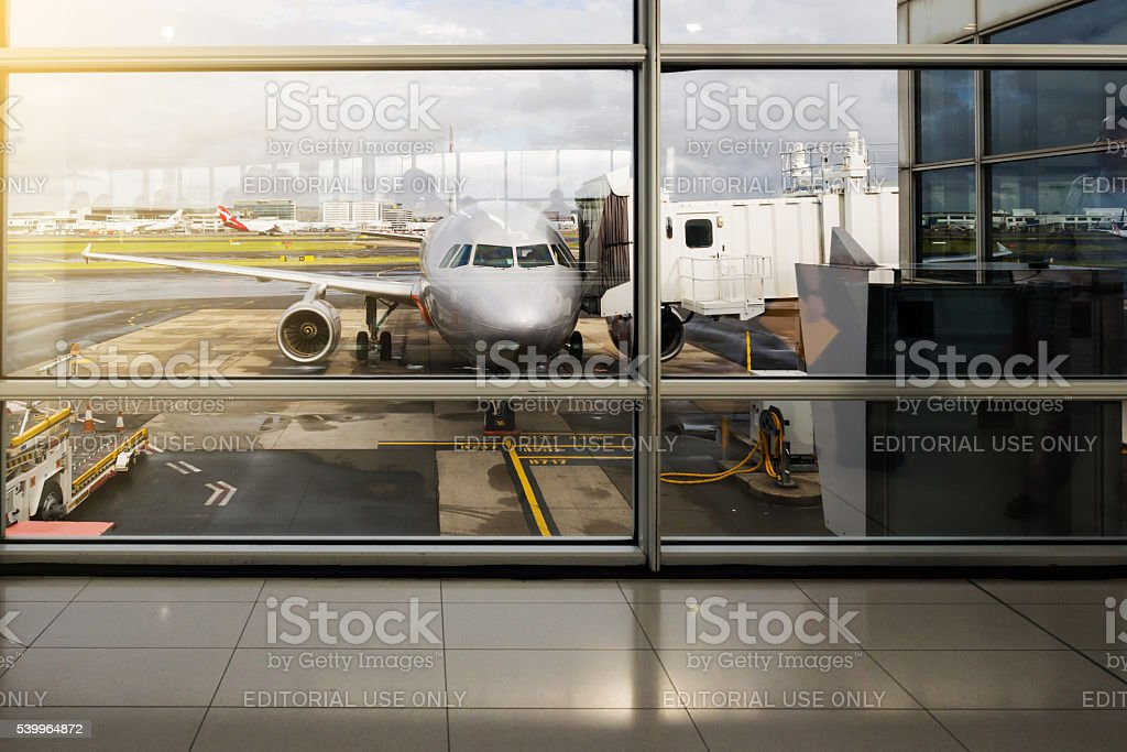 Plane at the gate after landing at the Sydney Airport. stock photo