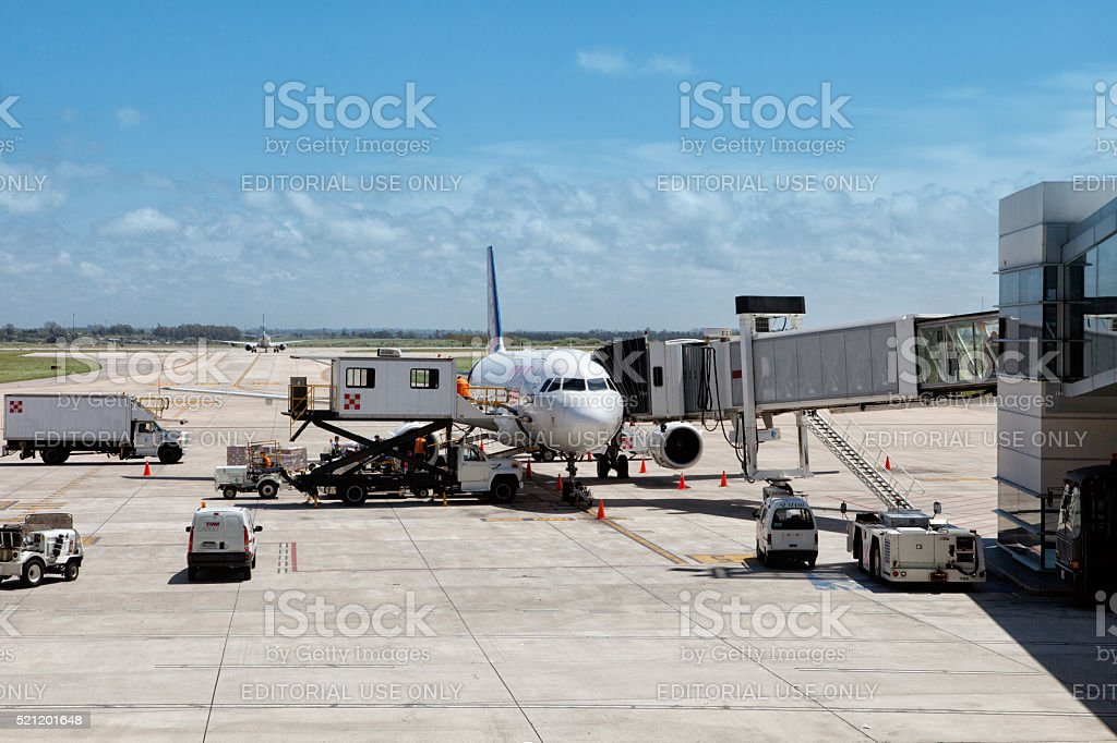 Plane being refueled before take off stock photo