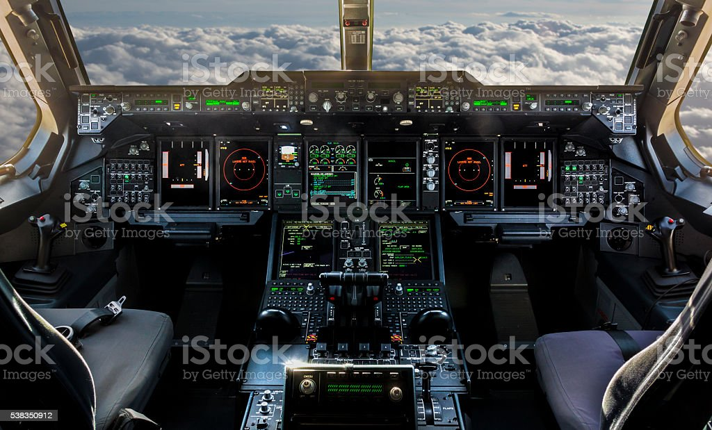 Plane cockpit and cloudy sky stock photo