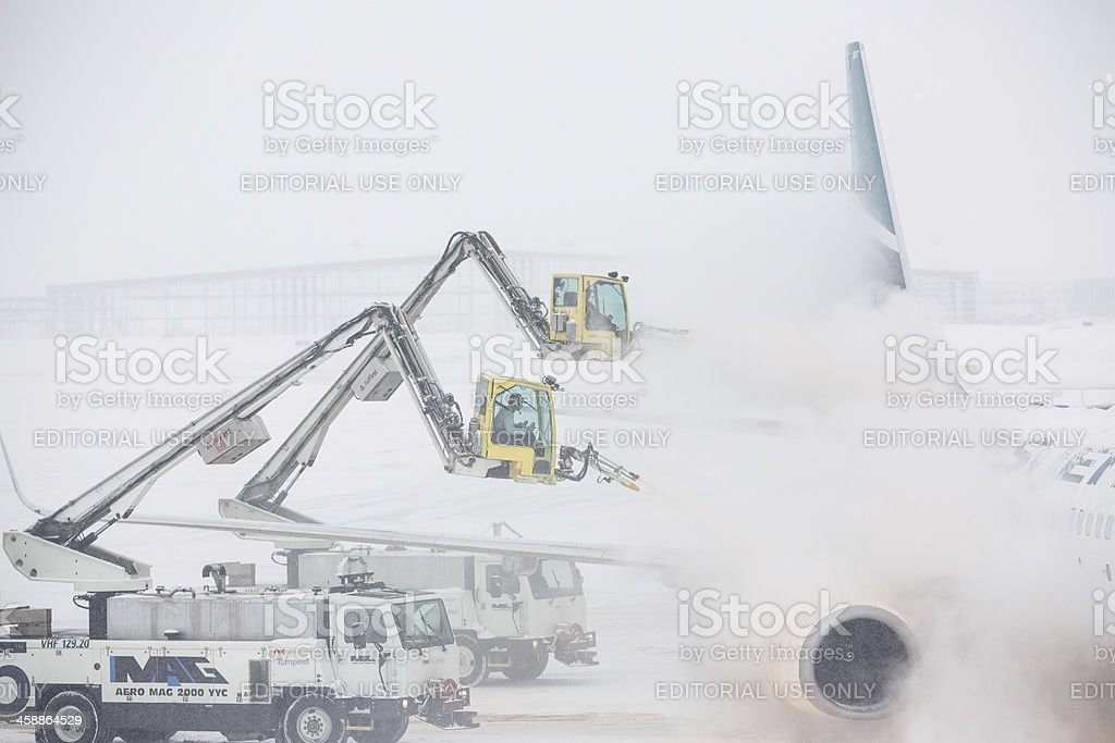 Plane De-Icing Operations stock photo
