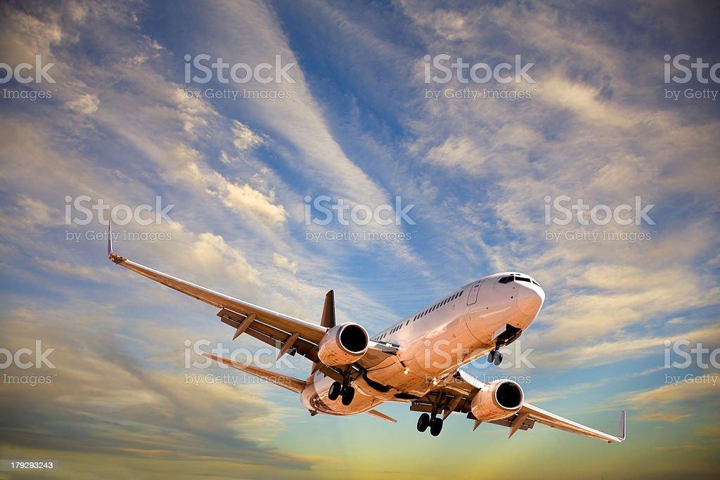 Plane Descending Through Moody Sky stock photo