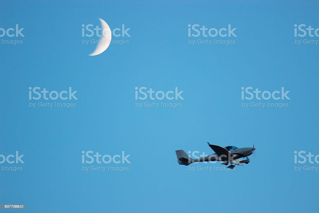 Plane fly above the land near moon stock photo