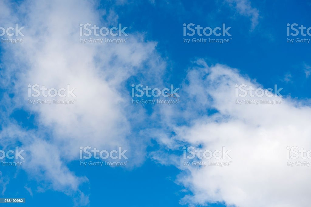 Plane flying above the clouds stock photo