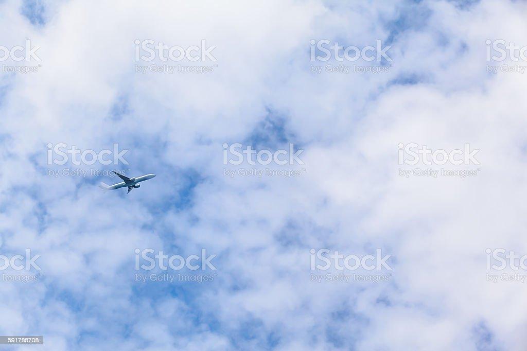 Plane Flying High stock photo