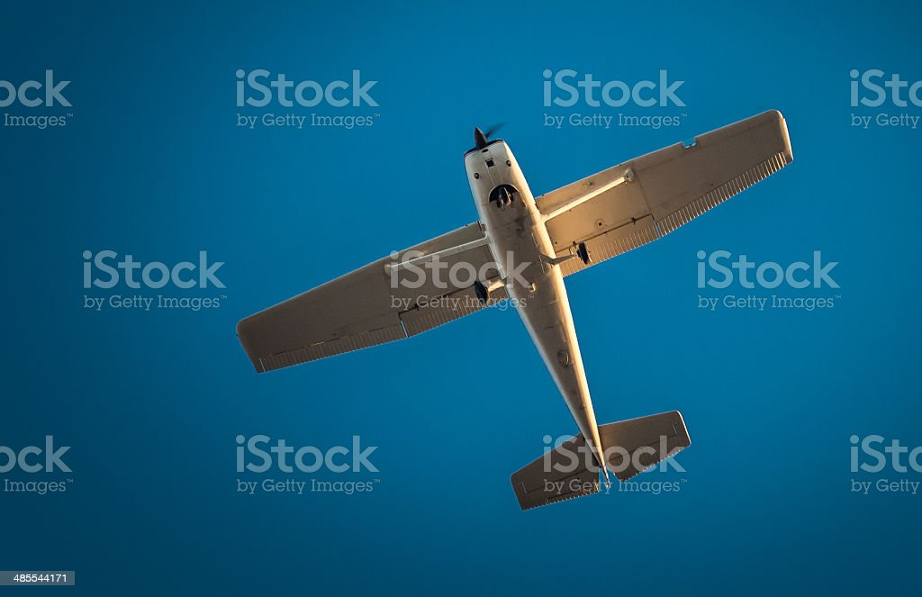 Plane From Underneath stock photo