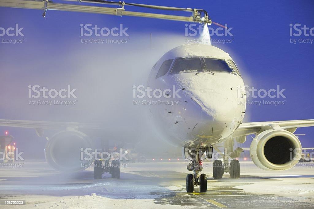 Plane having its wings de-iced stock photo