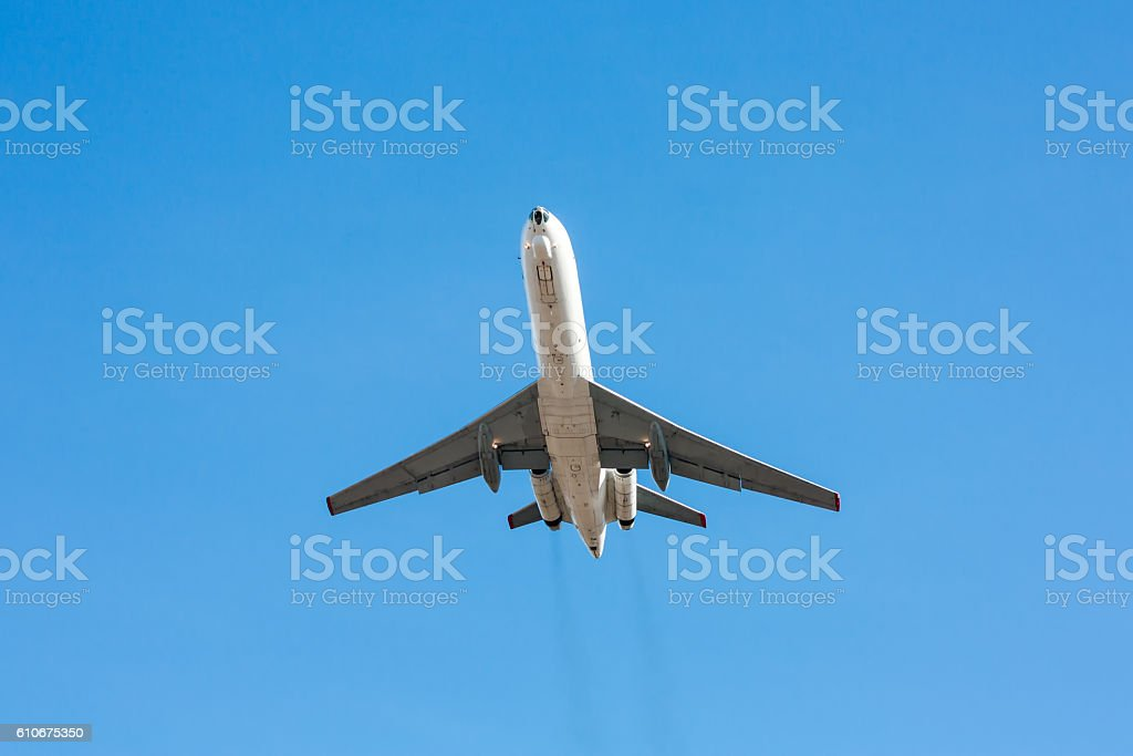 Plane in a blue sky royalty-free stock photo