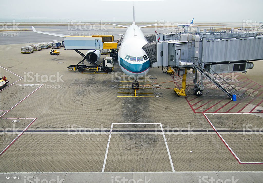 Plane in airport royalty-free stock photo