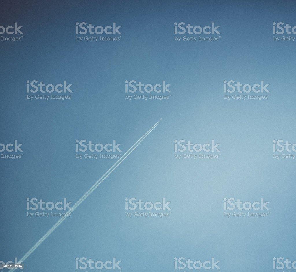 Plane in blue sky stock photo