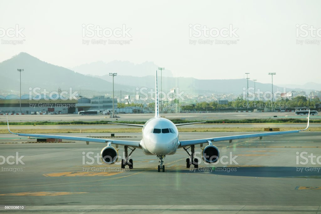 Plane in parking position on Barcelona airport stock photo