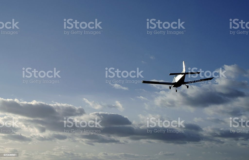A plane in the air during the sunset stock photo