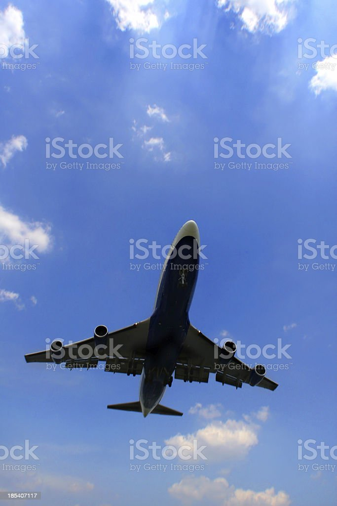 plane in the clowds royalty-free stock photo