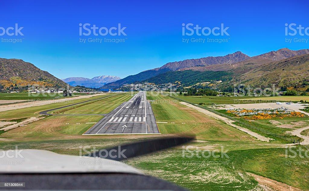 Plane landing from cockpit. stock photo
