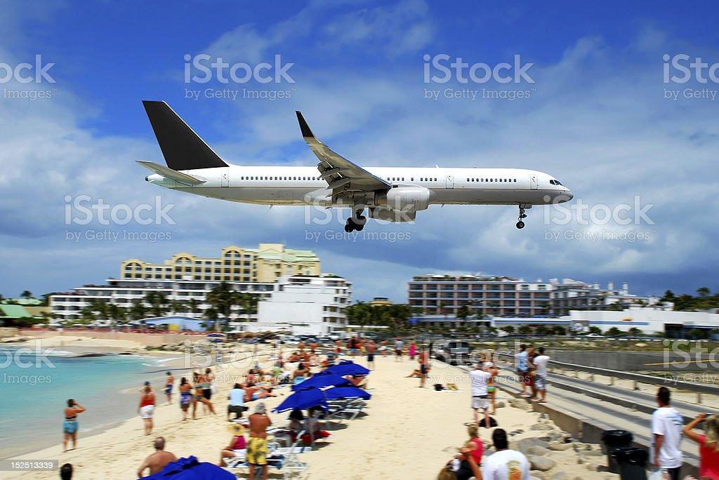 Plane Landing in St. Maarten stock photo