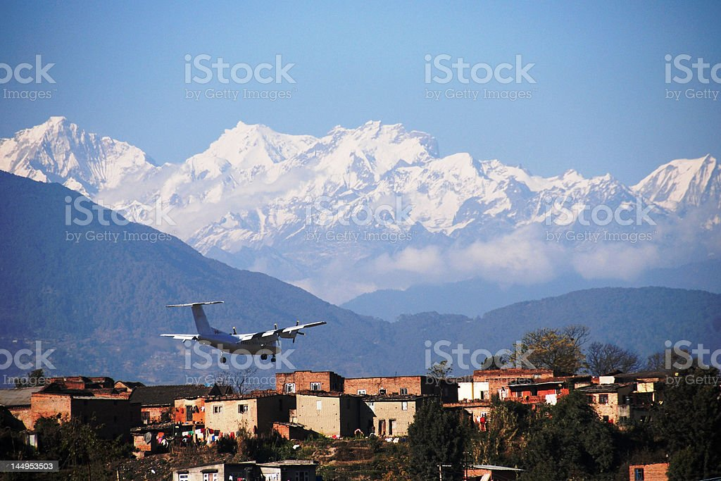 Plane landing in the Himalayas stock photo