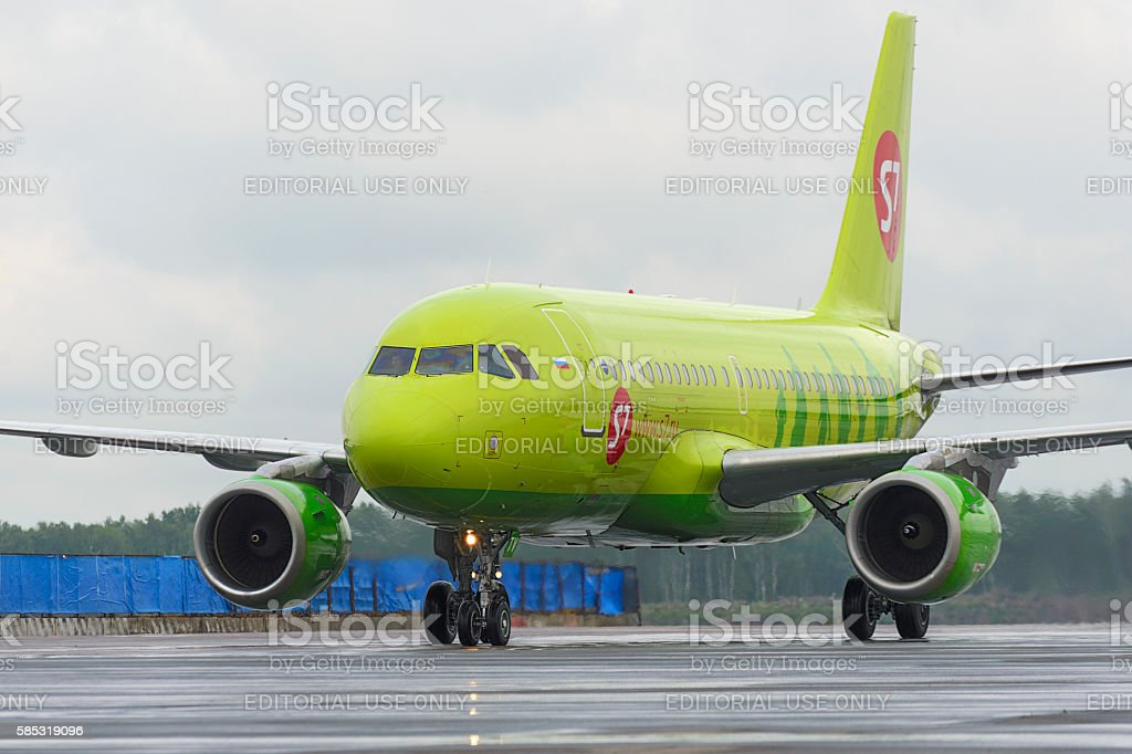 Plane makes taxiing on taxiway Domodedovo International Airport stock photo