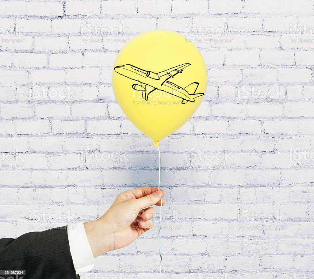 Plane on balloon stock photo