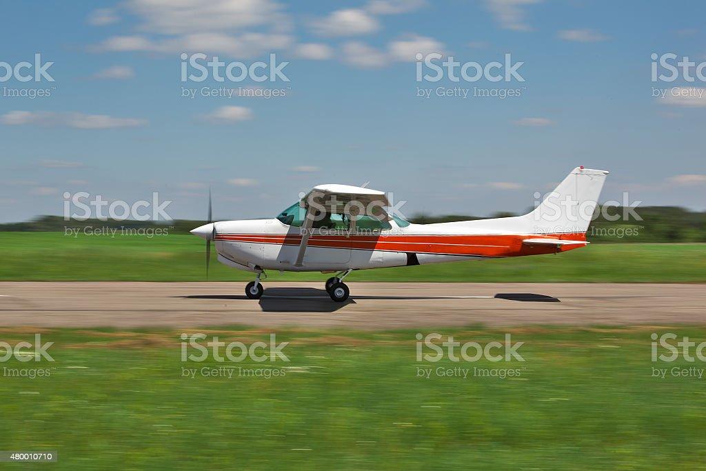 Plane on runway stock photo