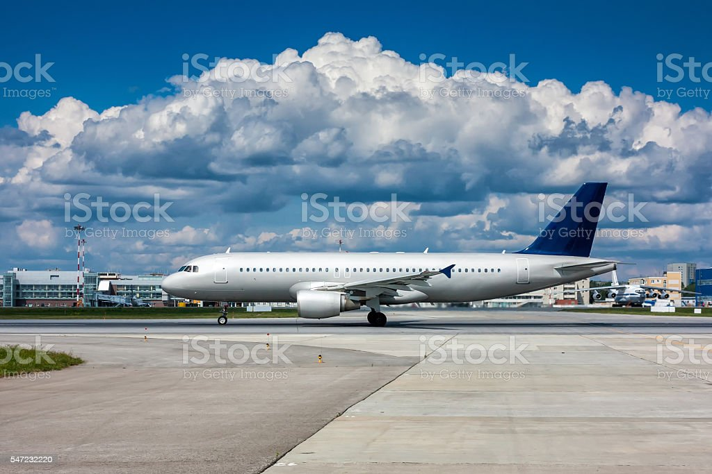 Plane on the runway with a beautiful textured sky royalty-free stock photo