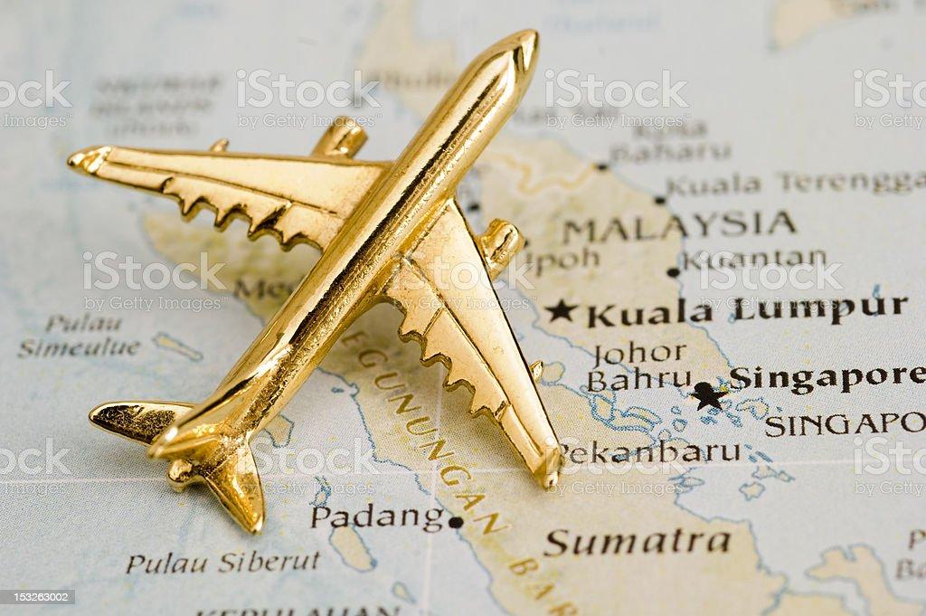 Plane over Malaysia stock photo