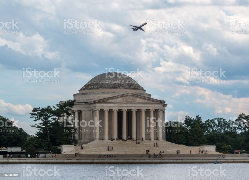 Plane over the JEfferson Thomas Memorial in DC stock photo