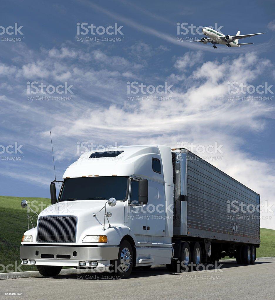 plane over truck stock photo