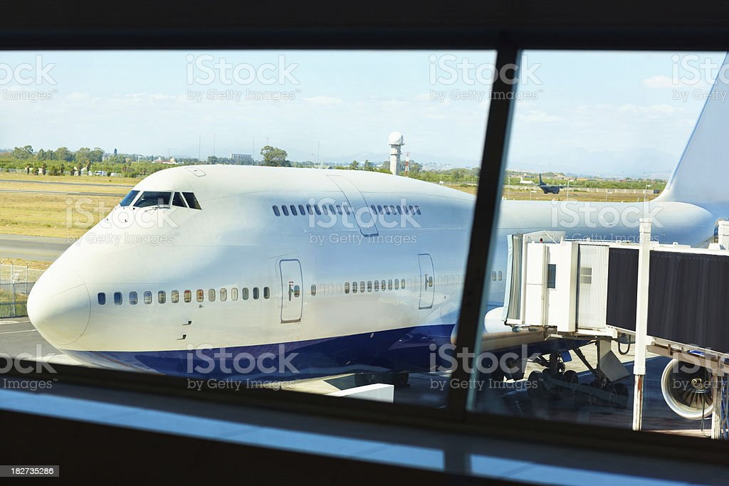 Plane parked at an airport royalty-free stock photo