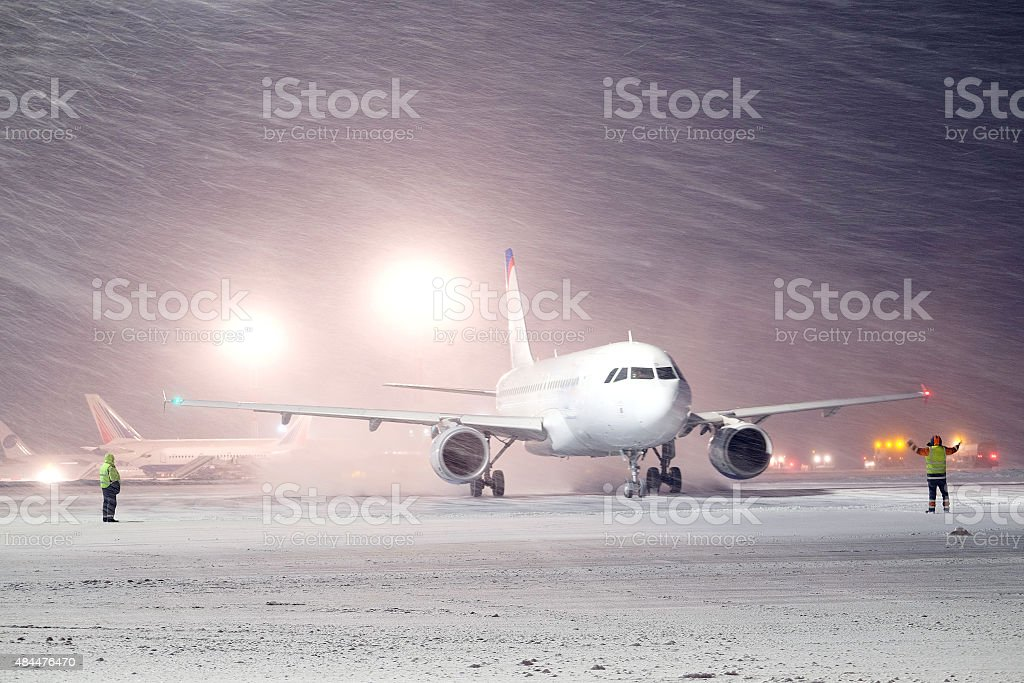 plane parked at the airport in winter stock photo