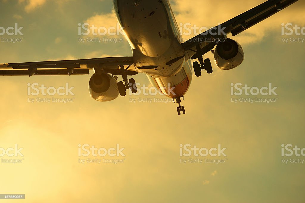 Plane ready to land against dramatic sky stock photo