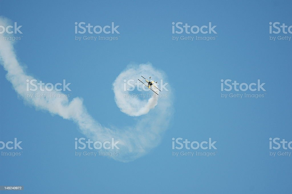 Plane rolling in a blue sky stock photo