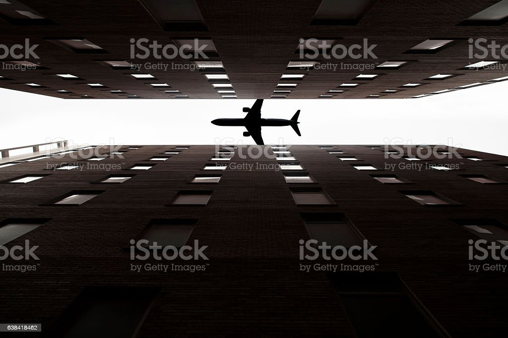 plane silhouette with skyscrapers stock photo