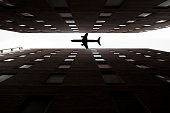 plane silhouette with skyscrapers
