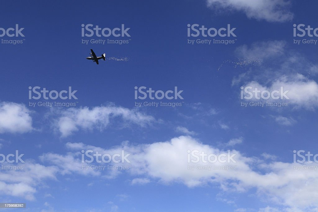 Plane spreading leaflets royalty-free stock photo