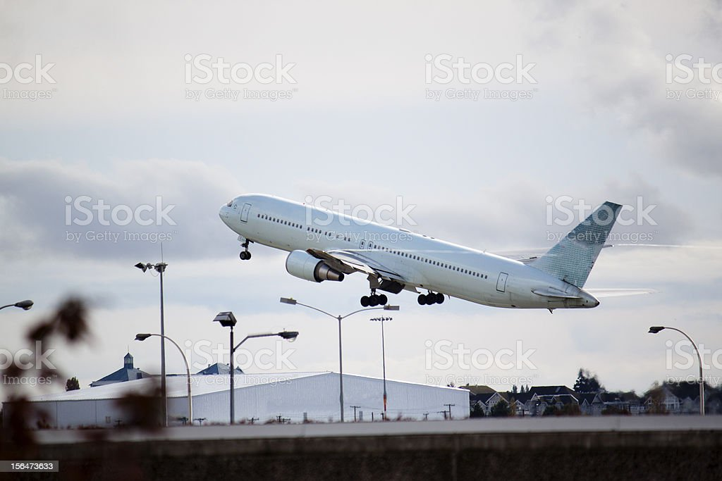 plane taking off royalty-free stock photo