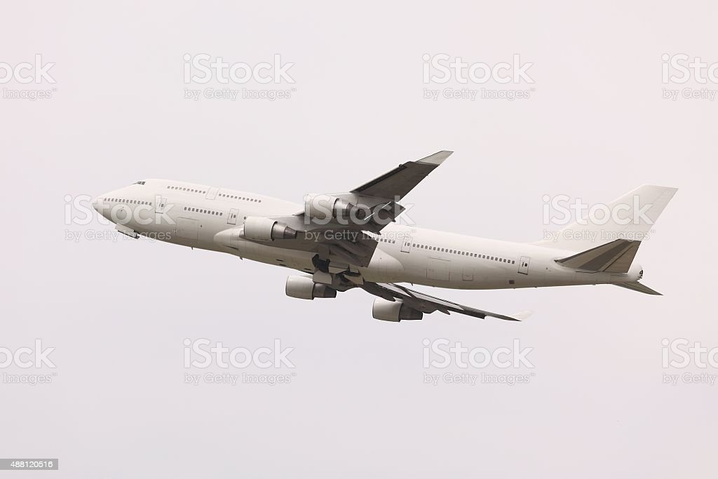 Plane taking off stock photo