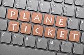 Plane ticket key on keyboard
