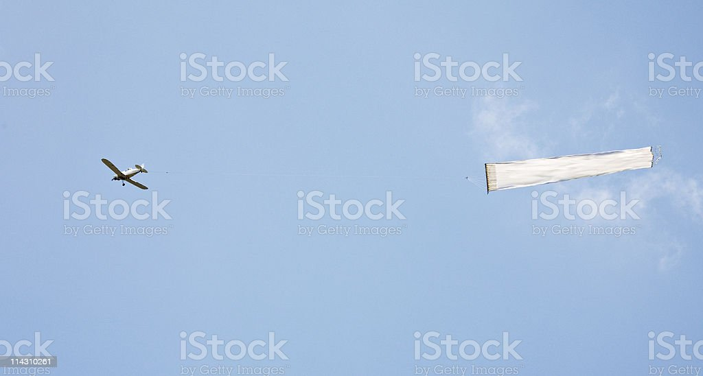 Plane towing blank banner stock photo