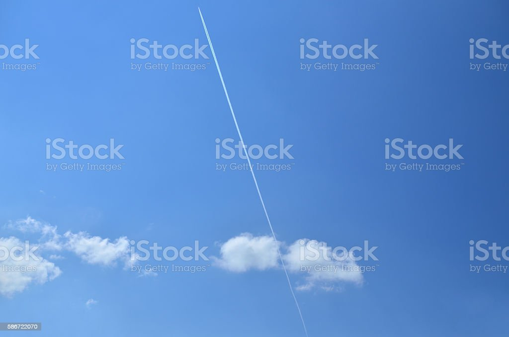 Plane Trail on a Blue Sky stock photo