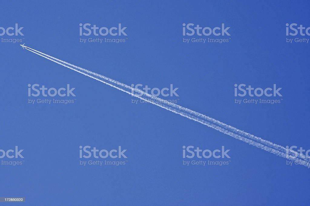 Plane with vapor stripes # 1 royalty-free stock photo
