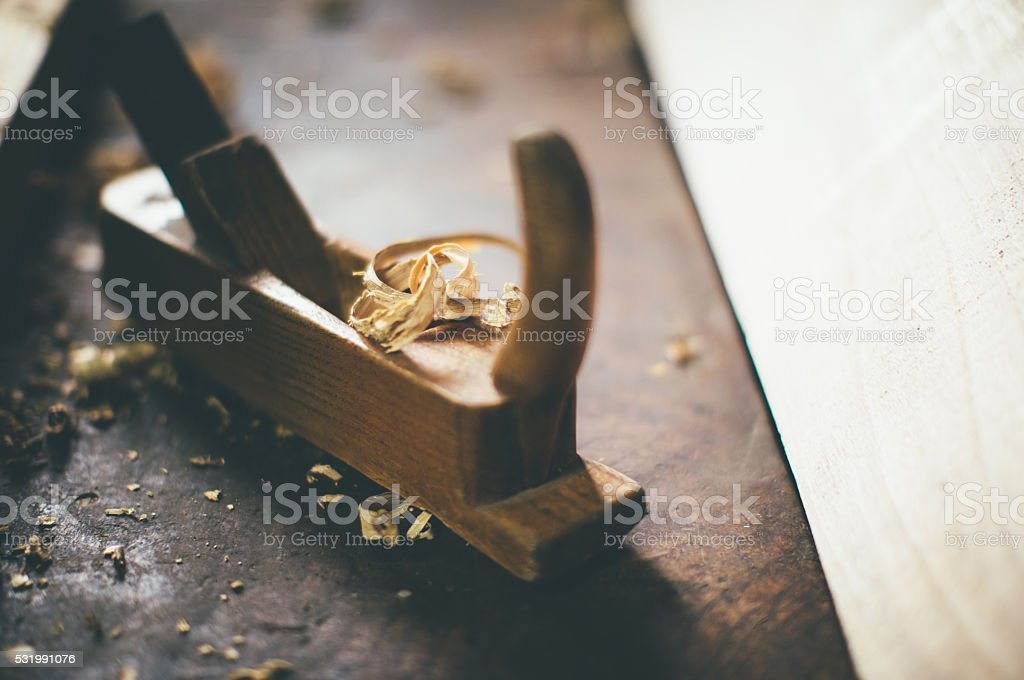 planer and sawdust stock photo