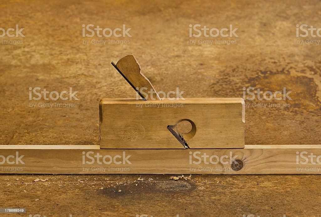 planer on wood in rusty background stock photo