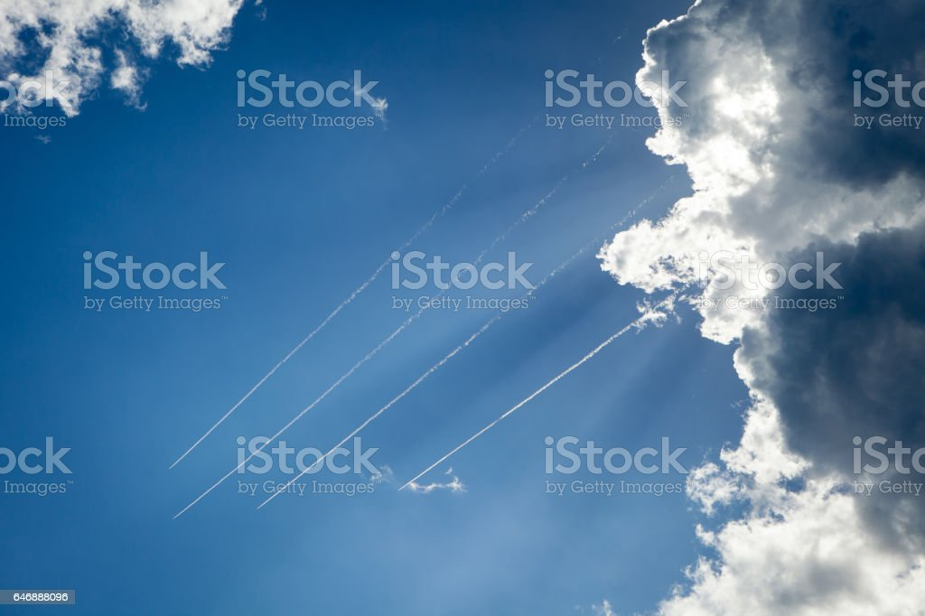 Planes flying across the sky leaving a trail stock photo