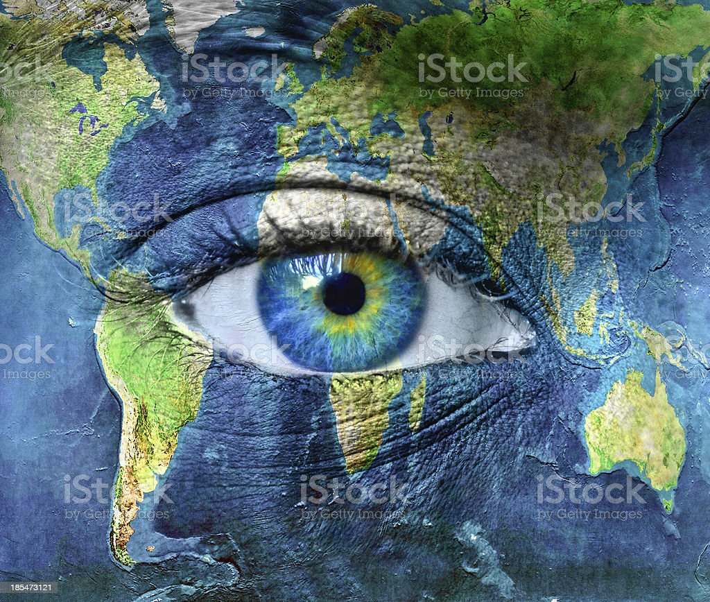 Planet earth and blue human eye stock photo